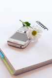 Notebook,mobile phone and flower Royalty Free Stock Photography