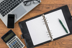 Notebook Mobile Phone and pen with calculator on the desk Stock Image