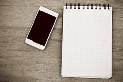 Notebook and mobile phone vintage style Royalty Free Stock Photo