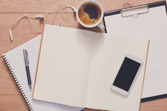 Notebook with mobile top view, study and office work Royalty Free Stock Photo