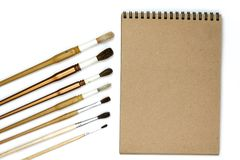Notebook mock up for artwork with watercolor paints isolated on white background. Branding stationery mockup scene, blank objects for placing your design royalty free stock photos