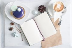 Notebook mock up over light background. Blank pages, opened notebook with sweets around Royalty Free Stock Photos