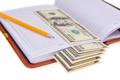 Notebook with money Stock Image