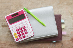 Notebook monthly planner and calculator for financial at office desk Royalty Free Stock Photos