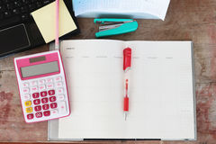 Notebook monthly planner and calculator for financial at office desk Stock Photos