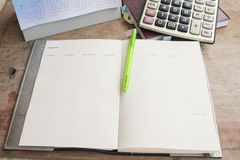 Notebook monthly planner record for financial Stock Images