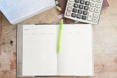 Notebook monthly planner record for financial. Background notebook monthly planner record for financial on office desk stock photo