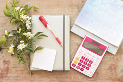 Notebook monthly planner record for financial on office desk Royalty Free Stock Images