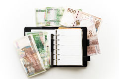 Notebook and more money Royalty Free Stock Photo