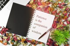 Notebook with motivational quote on background with dry flower petals. Motivational and inspirational quote. Self help and improvement wisdom quote Royalty Free Stock Photography