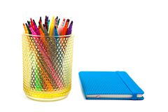 Notebook and multicolored markers on a white background Royalty Free Stock Photos