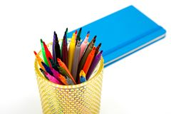 Notebook and multicolored markers on a white background Stock Photography