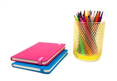 Notebook and multicolored markers on a white background Stock Images