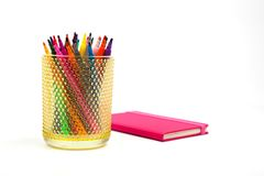 Notebook and multicolored markers on a white background Stock Photo