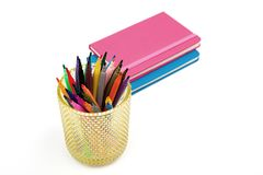 Notebook and multicolored markers on a white background Stock Image