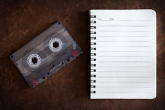 Notebook with music and cassette.  stock photo