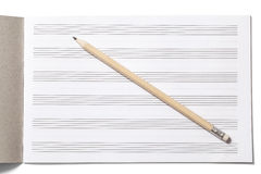Notebook for Musical Notes and Pencil Stock Image