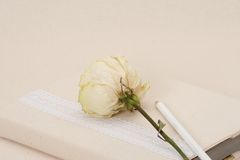 Notebook With Natural Linen Cover. Dried Rose. Stock Image
