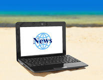 Notebook News on beach Stock Images