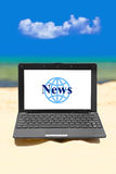 Notebook News on beach Royalty Free Stock Photos