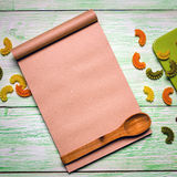Notebook with noodles on wooden Stock Photography