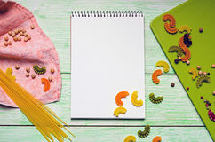Notebook with noodles on wooden Stock Images