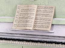 Notebook for notes on the piano Royalty Free Stock Images