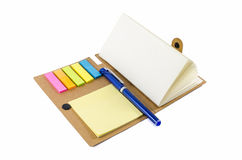 Notebook with notice papers and pen Royalty Free Stock Photo