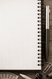 Notebook and office accessories royalty free stock photography
