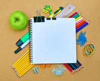 Notebook and office supplies royalty free stock photography