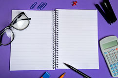 Notebook and office supplies Royalty Free Stock Images