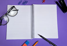 Notebook with office supply Stock Photos