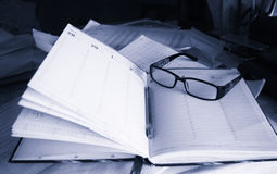 The notebook. Office working environment glasses pen notebook work Stock Photos