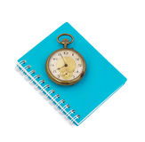 Notebook  with  old  clock vintage on white background Stock Image