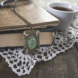 Notebook with old  necklace Stock Photos
