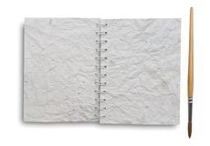 Notebook old papers with paint  brush Royalty Free Stock Image