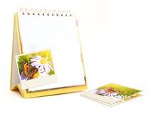 Notebook and old photos Stock Photos