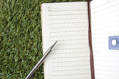 Notebook On Grass Royalty Free Stock Photography