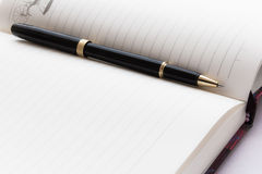 Notebook. Open notebook/ diary and pen close-up photo Royalty Free Stock Images