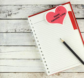 Notebook open with valentine day card Stock Photos