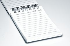 Notebook. Open notebook on a white background close-up Stock Image