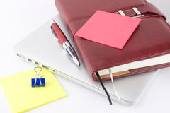Notebook and other things. On a laptop. White background Stock Image