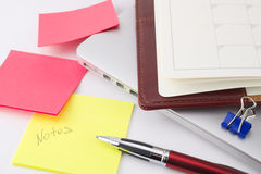 Notebook and other things. On a laptop. White background Stock Photos