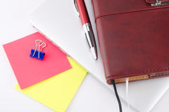 Notebook and other things. On a laptop. White background Royalty Free Stock Photos