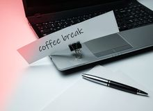 A notebook, a pack of paper, a pen and an ad on a stationery clothespin. The theme of the office and work. Side view stock photography