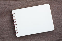 Notebook page on fabric Royalty Free Stock Images