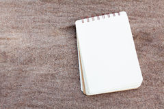 Notebook page on fabric Royalty Free Stock Photos