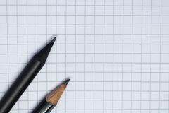 Notebook page with two pencils - Image. The notebook blank page with two simple pencils - Image royalty free stock photo