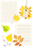 Notebook pages, labes and autumn leaves Stock Photos