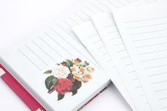 Notebook. And  pages with printed flowers Stock Photography